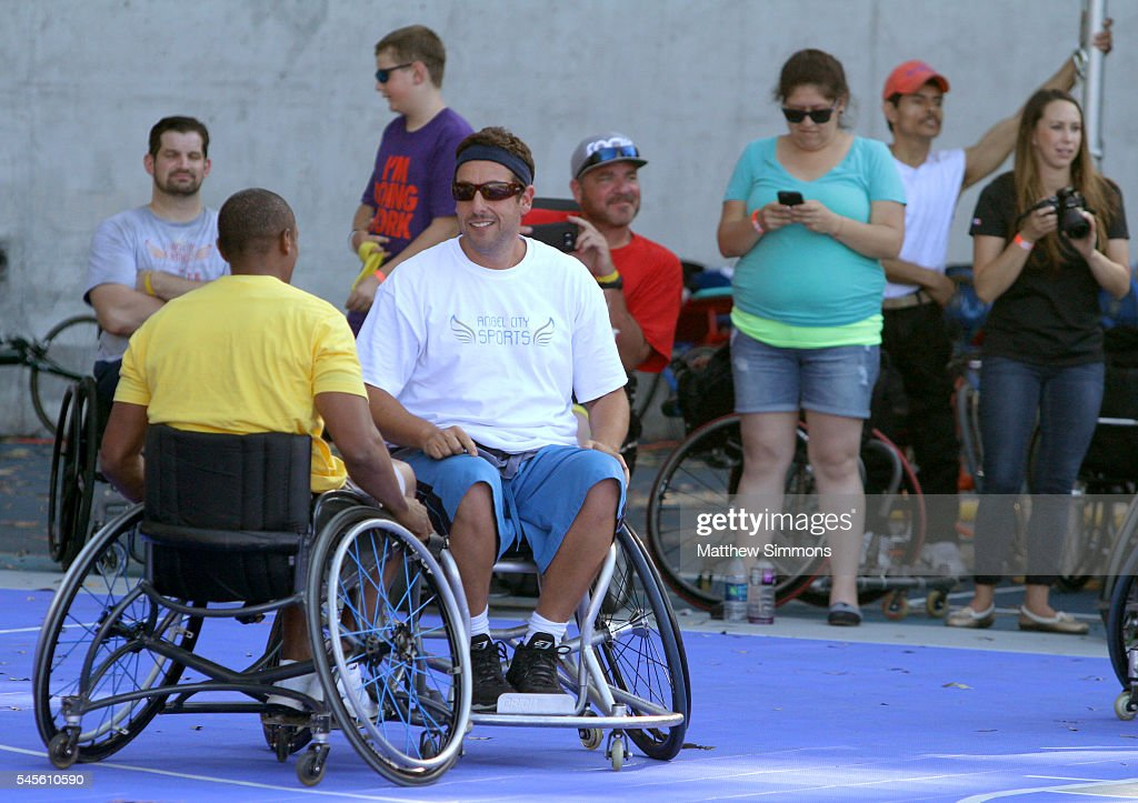Basketball player Tyus Edney amd comedian Adam Sandler play in a celebrity wheelchair basketball game during the 2nd Annual Angel City Games at...