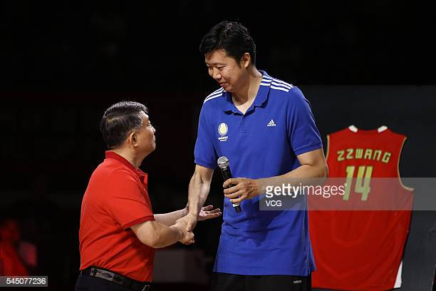 Basketball player Wang Zhizhi and Gong Luming head coach of China men's national basketball team attend Wang Zhizhi's retirement ceremony during a...