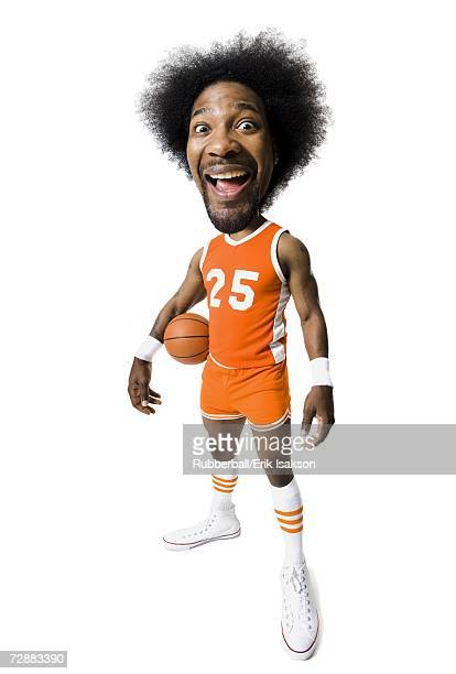 Basketball player with an afro in orange uniform