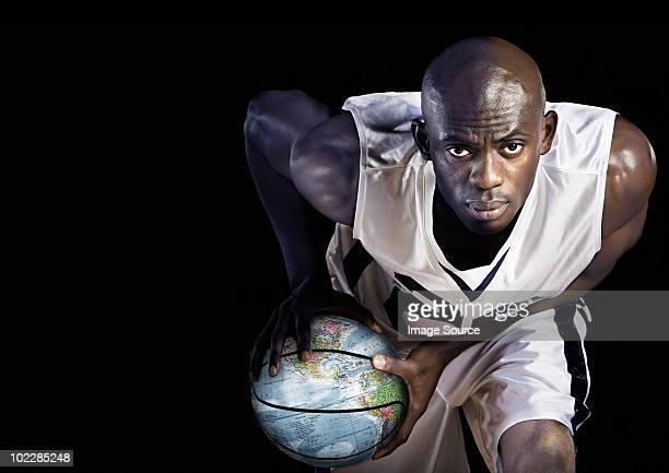 Basketball player with globe basketball