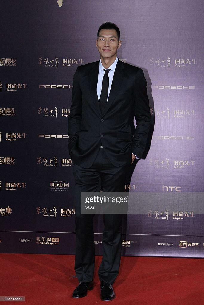 Basketball player Yi Jianlian attends Esquire Men Of The Year Awards 2013 at Oriental Theatre on December 4, 2013 in Beijing, China.