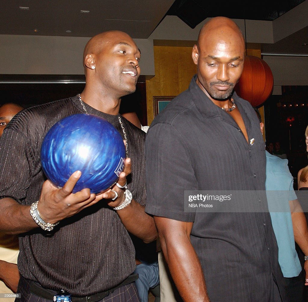 Basketball players Bryon Russell and Karl Malone get ready to bowl at a party held for Gary Payton and Karl Malone celebrating both Los Angeles Lakers players' birthdays at the Lucky Strike on July 24, 2003 in Los Angeles, California.
