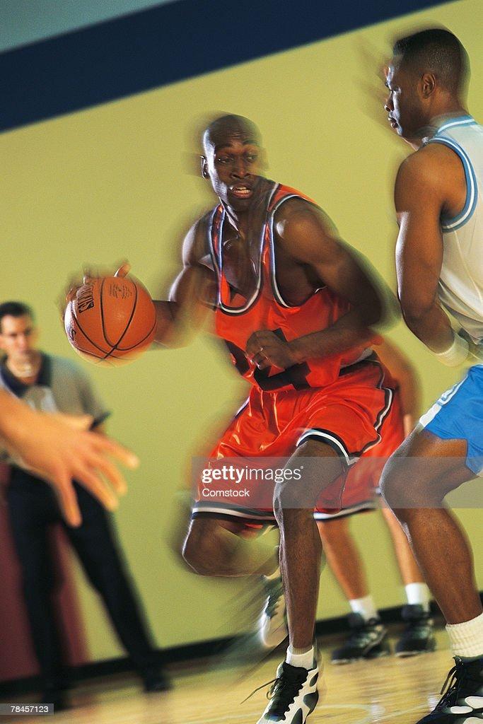 Basketball players competing : Stock Photo