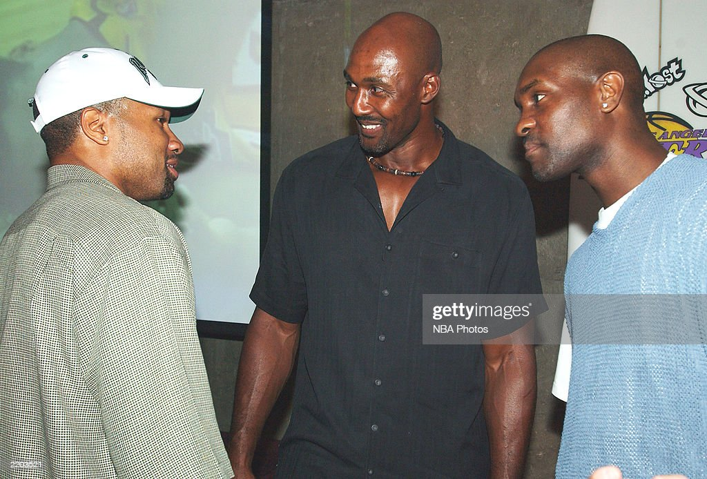 Basketball players Derek Fisher, Karl Malone and Gary Payton mingle at a party held for Gary Payton and Karl Malone celebrating both Los Angeles Lakers players' birthdays at the Lucky Strike on July 24, 2003 in Los Angeles, California.