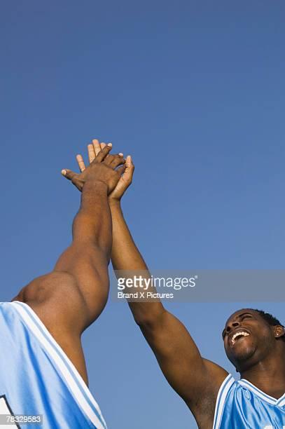 Basketball players doing a high-five