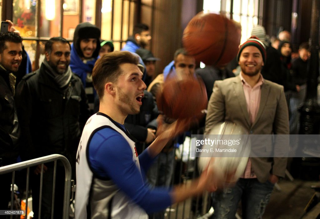 Basketball players entertain queuing gaming fans in Covent Garden ahead of the launch of the Playstation 4 on November 28, 2013 in London, England. PS4 consoles go on sale at midnight.