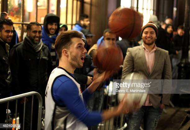 Basketball players entertain queuing gaming fans in Covent Garden ahead of the launch of the Playstation 4 on November 28 2013 in London England PS4...