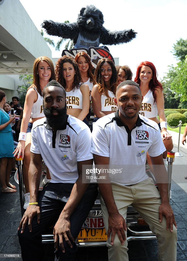 NBA basketball players James Harden (front L) of the Houston Rockets, Eric Gordon (front R) of New Orleans Pelicans pose for photos with Pacemates (back) and Grizz after a press conference in Manila on July 25, 2013. Harden and Gordon are here to promote the NBA pre-season games dubbed 'NBA 3X Asia' slated for October 2013.