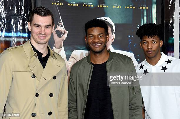 Basketball players Mario Hezonja CJ Wilcox Elfrid Payton attend the premiere of Warner Bros Pictures' 'Live By Night' at TCL Chinese Theatre on...