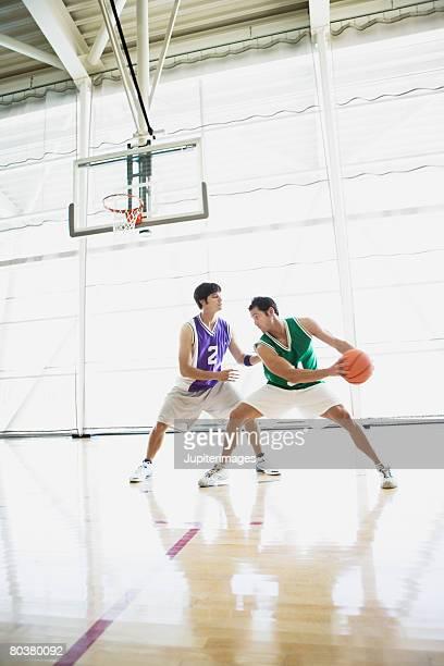 Basketball players on court