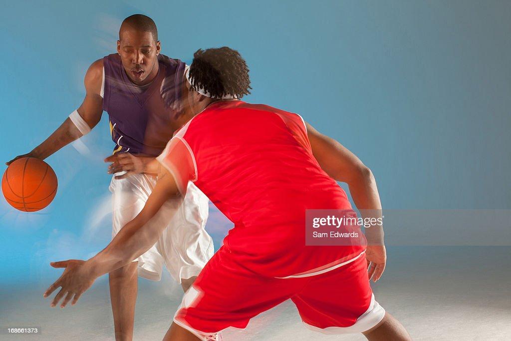 Basketball players playing basketball : Stock Photo