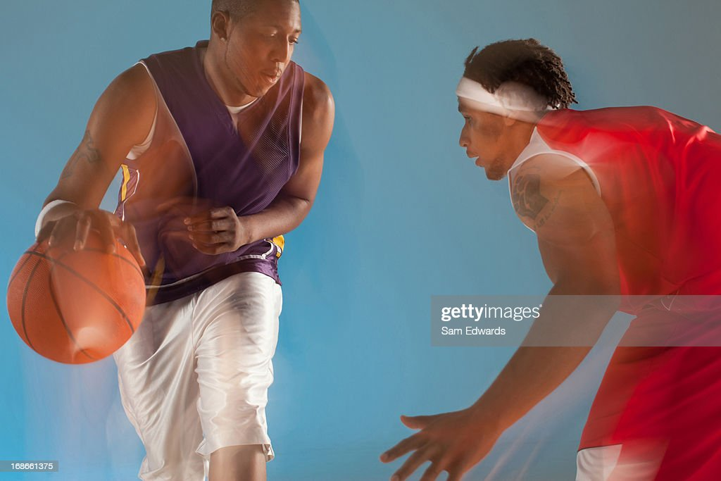 Basketball players playing basketball : Stock Photo