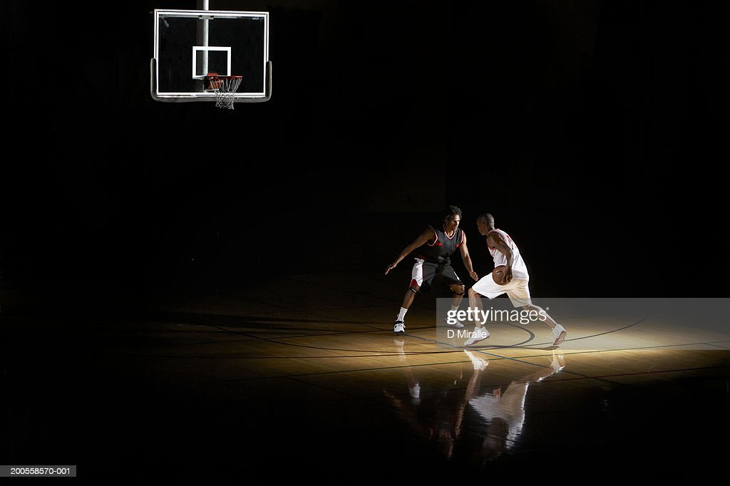 Basketball players playing one on one