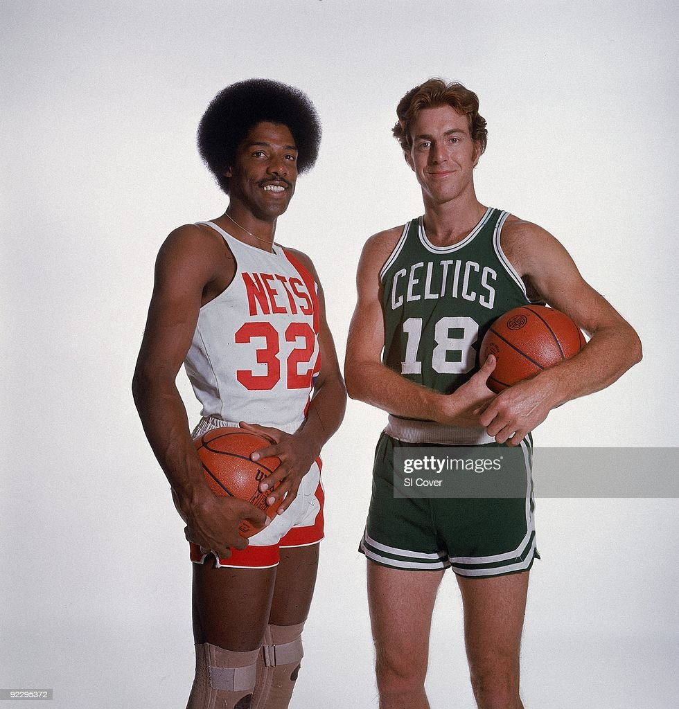 Boston Celtics Dave Cowen and New York Nets Julius Erving 1976