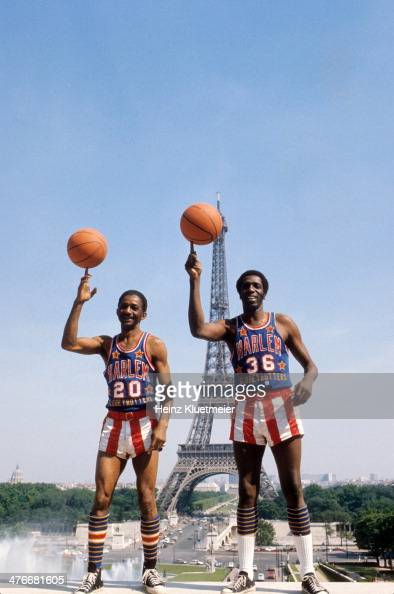 Portrait of Harlem Globetrotters Marques Haynes and Meadowlark Lemon spinning basketballs on fingertips during photo shoot at Jardins du Trocadero...