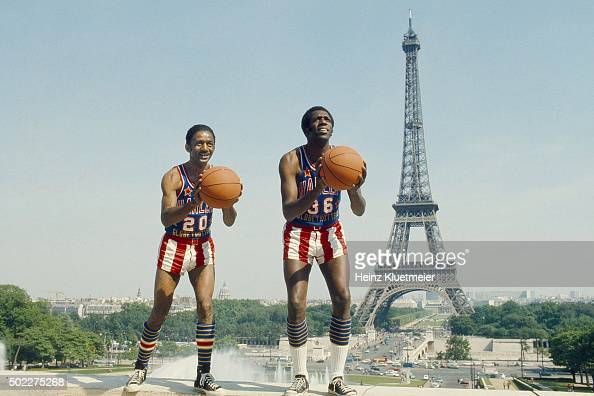 Portrait of Harlem Globetrotters Marques Haynes and Meadowlark Lemon posing during photo shoot at Jardins du Trocadero View of Eiffel Tower in...