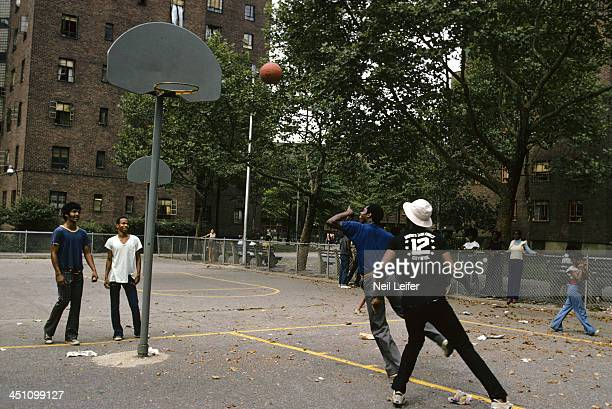 Portrait of Kansas CityOmaha Kings 'Tiny' Nate Archibald in action during pickup game at playground of Lester Patterson Houses Archibald who lives...
