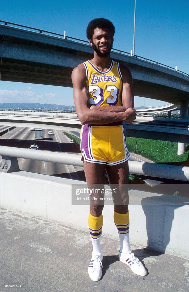 Portrait of Los Angeles Lakers Kareem Abdul-Jabbar posing next to freeway during photo shoot. John G. Zimmerman X19923 )