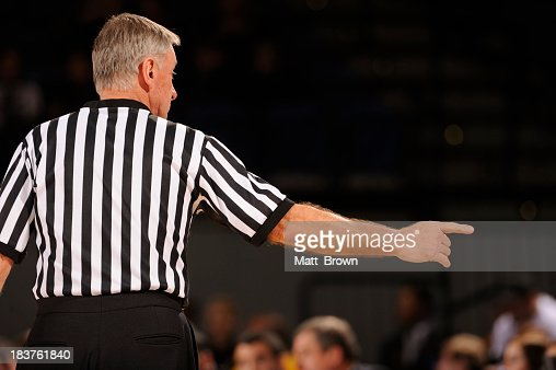 Basketball referee in gymnasium