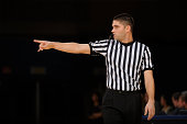 A basketball referee makes call during a game.