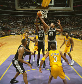 San Antonio Spurs David Robinson and Tim Duncan in action rebounding vs Los Angeles Lakers at Staples Center Los Angeles CA CREDIT John W McDonough