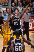 San Antonio Spurs Tim Duncan in action vs Los Angeles Lakers Robert Horry at Staples Center Los Angeles CA CREDIT John W McDonough