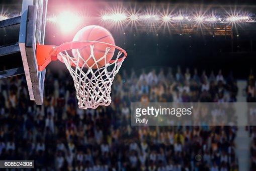 basketball scoring during match in arena : Stock Photo