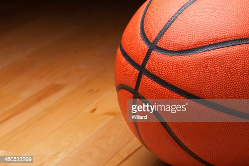 Basketball shot close up on hardwood gym floor : Stock Photo