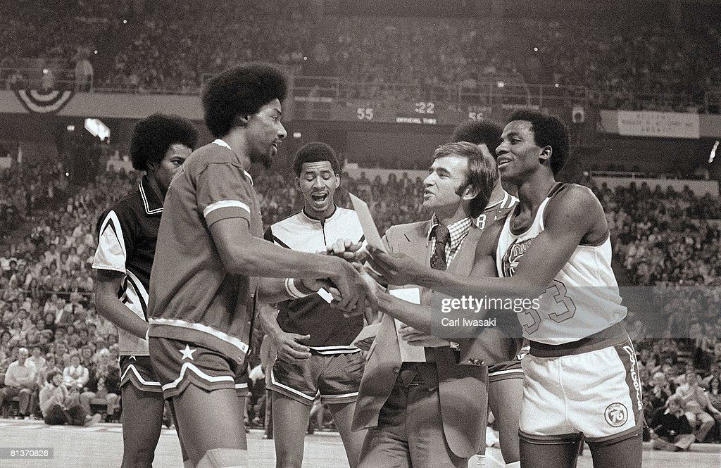 Slam Dunk Contest, New York Nets Dr, J, Julius Erving (32) shaking hands with Denver Nuggets David Thompson (33) on court before contest, Denver, CO 1/27/1976