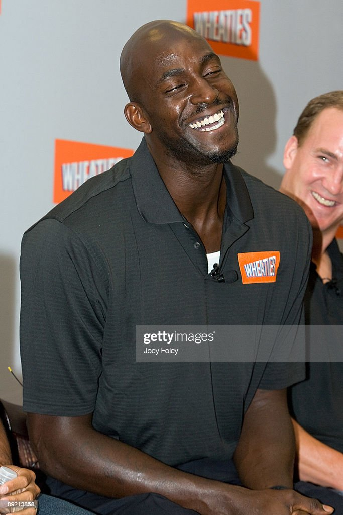 Basketball star Kevin Garnett and Indianapolis Colts quarterback Peyton Manning share a laugh during a press conference at Conseco Fieldhouse on July 23, 2009 in Indianapolis, Indiana.