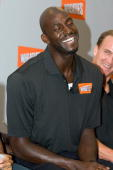 Basketball star Kevin Garnett and Indianapolis Colts quarterback Peyton Manning share a laugh during a press conference at Conseco Fieldhouse on July...