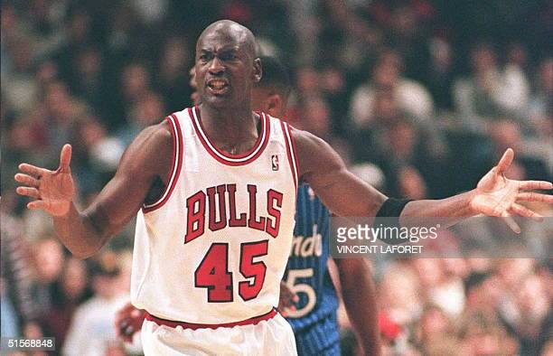 Basketball star Michael Jordan of the Chicago Bulls argues a foul call against him in the fourth quarter at the United Center in Chicago 24 March...