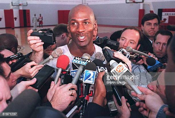 Basketball star Michael Jordan of the Chicago Bulls talks to the press 20 March after practice at the Berto Center in Deerfield Illinois Jordan...