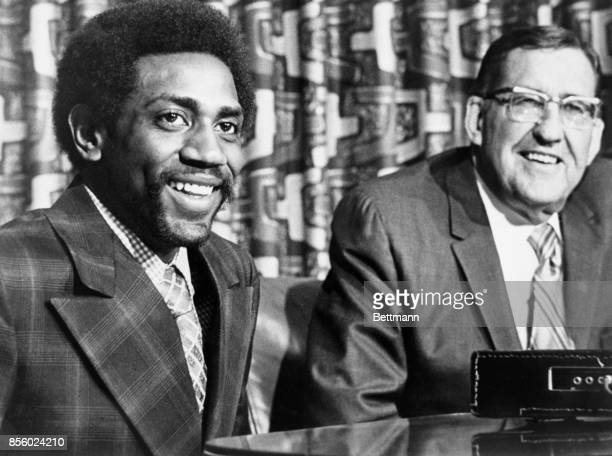 ABA basketball super star Spencer Haywood is all smiles after signing a new contract for $19 million Bill Ringsby owner of the Denver Rockets is...