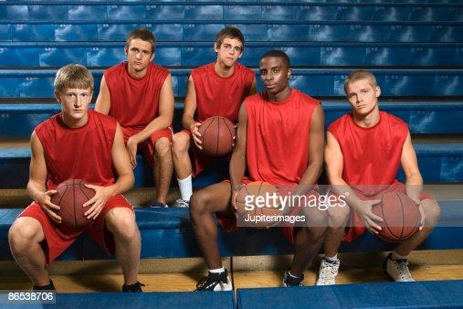 Basketball team sitting in bleachers