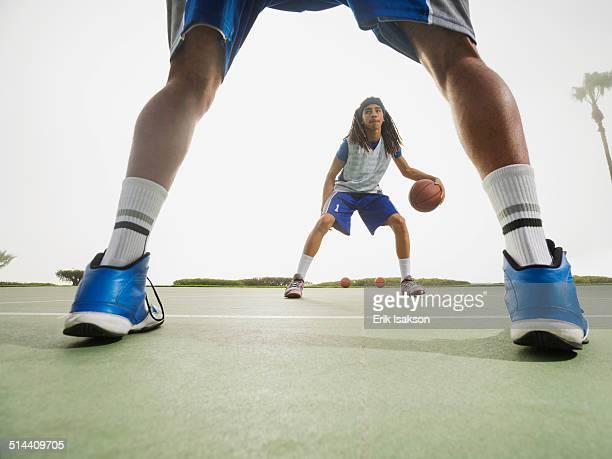 Basketball teams playing on court