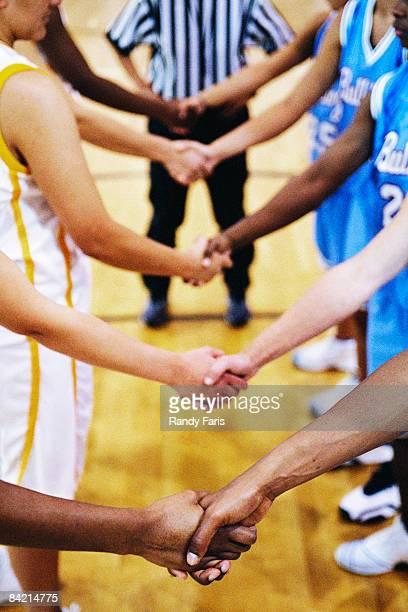 Basketball Teams Shaking Hands