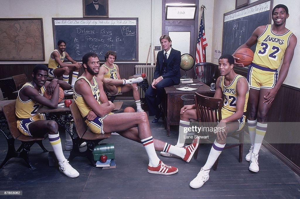 Team portrait of Los Angeles Lakers (L-R) Norm Nixon (10), Mitch Kupchak (41), coach Paul Westhead, Jamaal Wilkes (52), <a gi-track='captionPersonalityLinkClicked' href=/galleries/search?phrase=Magic+Johnson&family=editorial&specificpeople=157511 ng-click='$event.stopPropagation()'>Magic Johnson</a> (32), Kareem Abdul-Jabbar (33), and Michael Cooper (21) sitting in classroom set. Los Angeles, CA
