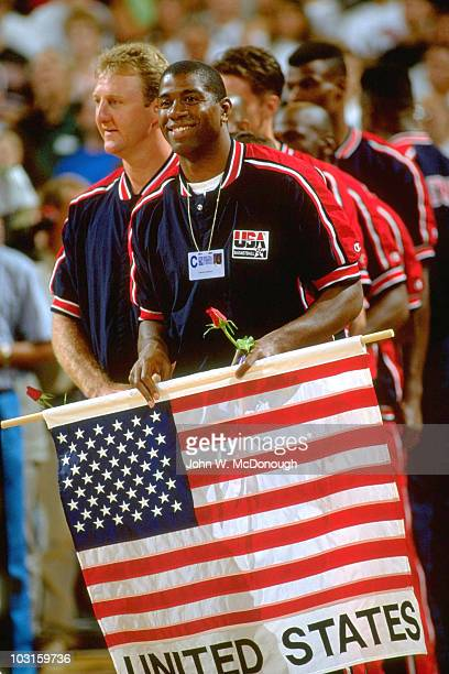 Tournament of the Americas USA Magic Johnson holding rose and flag before game vs Cuba Larry Bird in background Dream Team Portland OR 6/28/1992...