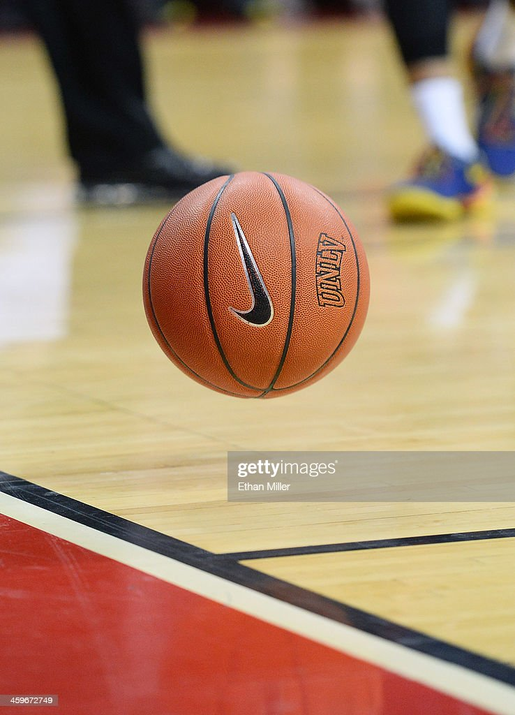 A basketball with a Nike logo bounces on the court during a game between the California State Fullerton Titans and the UNLV Rebels at the Thomas & Mack Center on December 28, 2013 in Las Vegas, Nevada. UNLV won 83-64.