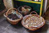 Baskets with dried aliments inside like dried tomatoes, mushrooms, raisins and roots