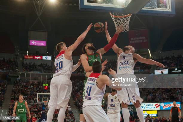Baskonia's Georgian forward Tornike Shengelias vies with CSKA's Russian forwards Andrey Vorontsevich and Nikita Kurbanov and American forward James...