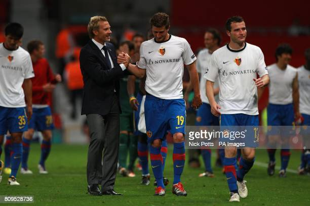 Basle manager Thorsten Fink with David Angel Abraham aftewr the game