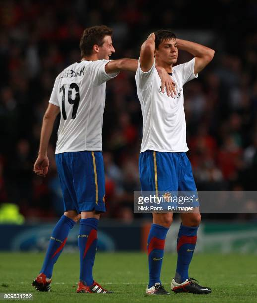 Basle's David Abraham and Aleksander Dragovic dejected after a missed chance by teammate Jacques Zoua