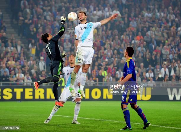 Basle's goalkeeper Yann Sommer punches clear under pressure from Chelsea's Branislav Ivanovic