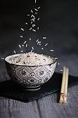 A bowl of basmati rice on dark background
