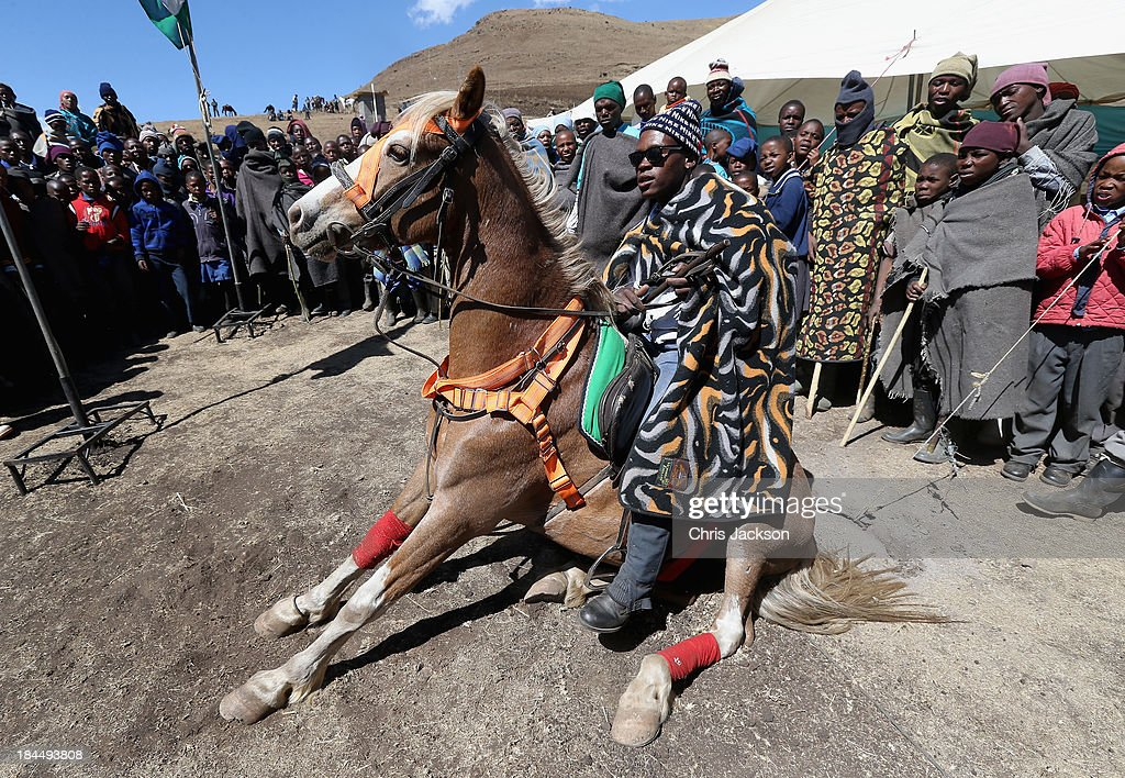 A Basotho man demonstrates his horsemanship skills during the opening ceremony of the new Sentebale Mateanong Herd Boy School on October 14, 2013 in Mokhotlong, Lesotho. Sentebale provides healthcare and education to the vulnerable children of Lesotho, a land-locked mountainous South African Kingdom. The charity was started in 2006 by Prince Seeiso of Lesotho and Prince Harry.