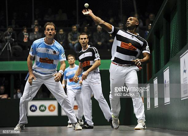 Basque pelota champions Philippe Bielle and Agusti Waltary compete during the final match of the Hand Pelota French championships on April 24 2016 in...