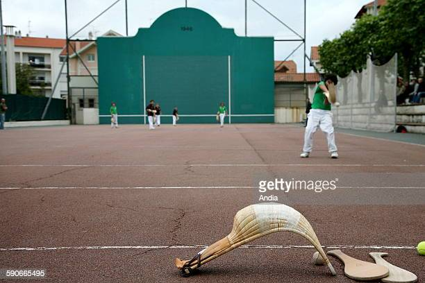 children during a game of pelota of 'Grand chistera' at the short court of Mazon Park in Biarritz Foreground chistera and two palas Chistera Cesta...