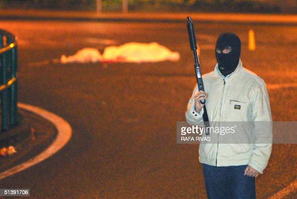 Basque policeman stands by the covered body of a policewoman Ana Arostegi shot by two suspected members of the Basque separatist group ETA in Beasain...